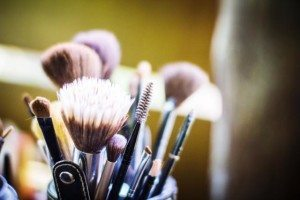Close-Up Of Make-Up Brushes Against Blurred Background